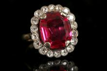 An 18ct gold, synthetic ruby and diamond set cluster dress ring.  Diamond: 0.90ct total est.  Size: P.
