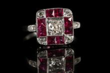An Art Deco 18ct white gold, diamond and ruby set dress ring.  Diamond: 0.40ct total est.  Ruby: 0.90ct total est.  Size: O.