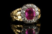 An antique 18ct gold, ruby and diamond cluster ring.  Ruby: 1.34ct, Burma, no heat.  Diamond: 0.60ct total est.  Size: Q.