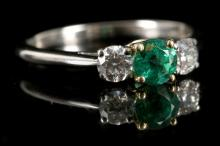 A Tiffany & Co, 18ct white gold / platinum, emerald and diamond set three stone ring.  Emerald: 0.50ct est.  Diamond: 0.60ct total est.  Size: T.  Sold together with the original Tiffany & Co insurance valuation and covering letter (x 2).