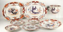 MASON'S PATENT IRONSTONE CHINA: A collection of plates and platters, each decorated in Imari taste with a 'Japan' pattern of a stylised Chinoiserie landscape within formal borders, sold together with a chamber pot (8)