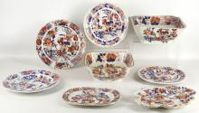 MASON'S PATENT IRONSTONE CHINA: A collection of china items, each elaborately decorated in Imari style in the 'Japan' pattern of a stylised landscape scene of birds perched amongst oriental flowers, to include plates, serving dishes, and a scalloped dessert dish (8)