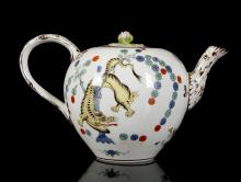 A MEISSEN KAKIEMON TEAPOT AND COVER, second half 19th century, of bullet-shaped form with a flattened cover and rose bud finial, painted in Kakiemon style with the 'Yellow Tiger' (Gelber Löwe) pattern, the tiger coiled around a blue bamboo stalk to one side, a flowering prunus tree to the other, the handle and spout moulded to simulate wood picked out in brown, 12cm high, crossed swords mark in blue, impressed numerals (minor chips to rim)