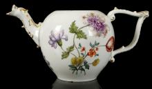 A MEISSEN TEAPOT, circa 1750, the bullet-shaped form with a scroll-moulded tau handle and bird head spout picked out in gold, finely painted to both sides with large sprays of flowers or 'Holzschnittblumen'and further scattered flowers, 10cm high, crossed swords mark in underglaze blue (cover lacking)