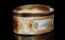 A SÈVRES STYLE PORCELAIN BOX, late 19th century, with gilt-metal mounts, the oval form painted to the cover with a courting couple seated in a landscape setting in the style of Watteau, within an elaborate tooled gold and jewelled border, the sides with landscape vignettes and star-shaped medallions alternating in blue and red, the interior painted with floral sprays, 8.5cm wide, interlaced LL monogram in blue