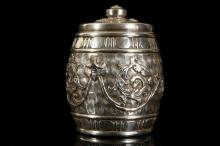AN UNUSUAL ROYAL DOULTON SILVERED STONEWARE BISCUIT BARREL, dated 1912, the barrel-shaped form moulded in relief with scrolling foliage on a swirling ground, the exterior silvered, the rim and finial with hallmarked sterling silver mounts by Gourdel, Vales & Co., Chester 1912, 414.5cm high, impressed factory marks and numerals (cover restuck)