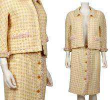 CHANEL SKIRT SUIT, early 1990s, pink, yellow, cream and lame bouclé wool with fringed edging, the jacket with bracelet sleeves and two front pockets, the skirts button-down and knee length, size 40 (2)