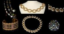 1980s COSTUME JEWELLERY, to include a gilt metal belt, each loop signed 'M', a gilt metal and diamanté necklace, a diamanté cuff, a faceted necklace and a brooch (5)
