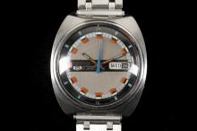 A c.1970's gents stainless steel cased 'Seiko' automatic wristwatch, with grey dial, day-date and articulated bracelet.