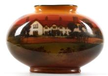 A RARE EARLY 20th CENTURY ROYAL DOULTON PORCELAIN VASE, painted with country home in evening landscape view, possibly painted by H. Morrey, unsigned, 6cm high.
