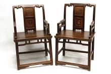 A PAIR OF CHINESE ZHAZHENMU CHAIRS. Late Qing Dynasty, 19th Century. The arms and back with an open latticework design, the backsplat with two panels, one with figures, the other with flowers, below a ruyi-head form headrest, 98cm H. (2) Provenance: