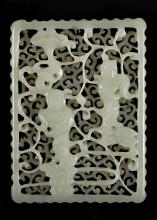 A CHINESE WHITE JADE CARVED AND RETICULATED PLAQUE.   Qing Dynasty, 18th / 19th Century.   Carved and pierced on two levels with a pair of boys borne on swirling clouds in front of swirling patterns, 4.5 x 6.5cm.   ?? ????
