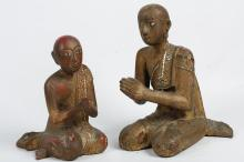 TWO BURMESE CARVED WOODEN PRAYING FIGURES.   19th Century.   (2)