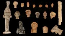 A GROUP OF CLASSICAL TERRACOTTAS AND OTHER ARTEFACTS   Circa 4th B.C. to 2nd Century A.D. Including seven Greek and Hellenistic female heads, 2cm-7cm high; and five male heads including a head of Silenus, 2cm-5.5cm high; two Roman vessel fragments, one in the shape of a bull?s head and another as a bust of Aphrodite, 4cm-7cm long; a Roman bone doll, 16cm long; and two After the Antique figures, Not Ancient, 8.5cm-21.5cm high (17)   Provenance: Marcus Brooke (1923-2015) Collection, Glasgow, formed in the 1960s-1970s.