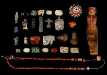 A GROUP OF EGYPTIAN HARDSTONE AND BRONZE AMULETS AND FRAGMENTS  Second Intermediate Period to Ptolemaic Period, circa 1786-30 B.C.  Including a steatite 'sma' amulet, a squatting baboon with plumed headdress, a Ptolemaic steatite Baubo amulet, a Ramesside plaque for Tuthmosis III, another plaque with kneeling royal figure and one with fish, a scarab with figure of Ptah and three others, three udjat eyes, a hematite scarab, a lapis lazuli squatting baboon, a bronze headdress, 11-35mm long;and a group of carnelian beads; together with four hardstone amulets including a carnelian frog, 14mm-40mm long, possibly Not Ancient; and three other After the Antique artefacts (29)  Provenance: Antoni Sikorski Collection, London, formed between the 1950s-1970s. Antoni Sikorski was born in Poland and then joined the Polish Armed Forces in the West during WWII fighting alongside the British Army. After the war he settled in London where he formed his collection.
