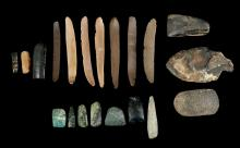 TWENTY EGYPTIAN STONE IMPLEMENTS  Circa 4th Millennium B.C.  Including nine flint blades, a flint core, and a spearhead, 2.7cm-9cm long; and nine grey, green and black polished stone miniature axeheads, 2.5cm-5.5cm long (20)  Provenance: Horatio and Patsy Melas Collection, Alexandria, Egypt, acquired before 1967. Thence by descent, moved to Switzerland and London.