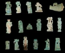 SEVENTEEN EGYPTIAN GREEN GLAZED COMPOSITION AMULETS  Late Period, circa 664-332 B.C.  Representing the Hedjet crown of Upper Egypt, a miniature sow, and various deities including Pataikos, Shu, Anubis and other examples, 9mm-21mm (17)  Provenance: Horatio and Patsy Melas Collection, Alexandria, Egypt, acquired before 1967. Thence by descent, moved to Switzerland and London.