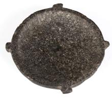 AN EGYPTIAN BASALT SHALLOW DISH  Late Period, circa 664-332 B.C.  With flat base and four rectangular lugs around the rim, 11cm diam   Provenance: Horatio and Patsy Melas Collection, Alexandria, Egypt, acquired before 1967. Thence by descent, moved to Switzerland and London.