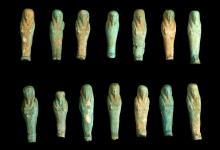FOURTEEN EGYPTIAN GLAZED COMPOSITION SHABTIS  Late Period, circa 664-332 B.C.  Flat-backed, the mummiform figures holding farming tools, 5.6cm-6.7cm long (14)  Provenance: Horatio and Patsy Melas Collection, Alexandria, Egypt, acquired before 1967. Thence by descent, moved to Switzerland and London.