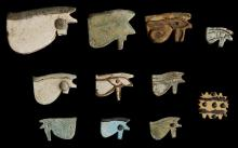 ELEVEN EGYPTIAN GLAZED COMPOSITION UDJAT EYE AMULETS  Third Intermediate Period, circa 1069-702 B.C.  Including a yellow example of multiple eye amulet, some amulets with details added in relief, all pierced for suspension, 2cm-5cm long (11)  Provenance: Horatio and Patsy Melas Collection, Alexandria, Egypt, acquired before 1967. Thence by descent, moved to Switzerland and London.