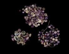 A GROUP OF ROMAN AMETHYST, ROCK CRYSTAL AND GARNET BEADS  Circa 1st-3rd Century A.D.  Of spherical, biconical and tear shape, some restrung into a necklace and a bracelet with modern string, 4mm-19mm long (a lot)    Provenance: Horatio and Patsy Melas Collection, Alexandria, Egypt, acquired before 1967. Thence by descent, moved to Switzerland and London.