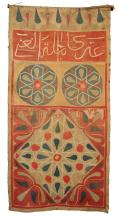 AN OTTOMAN APPLIQUE' COTTON 'KHAYAMIYA' TENTMAKER'S PANEL  Egypt, circa 1900   Of rectangular shape, decorated with applied polychrome patches forming a square panel at the bottom and two roundels in the centre with petal motifs, and an inscription at the top, 175cm x 90cm