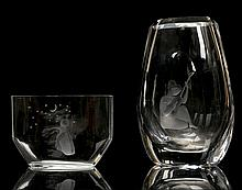 ORREFORS, SWEDEN - a mid 20th century clear glass vase, with girl playing a lute etched to front, engraved marks under, together with a bud vase by the same maker, called 'A Wish to the Moon' designed by Edvin Ohrstrom, with engraved marks under, (23cm high, 11cm high)