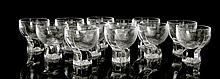 A SET OF TWELVE 1970's ITALIAN DRINKING GLASSES - clear crystal glass of modernist form, with textured exterior, on block base, (9cm diam)