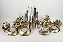 A COLLECTION OF TEN MID 20TH CENTURY LIGHTING - to include four Reggiani table lamps with adjustable heads, in gilt metal finish, a chrome, nine light 1970's Italian circular ceiling light, with tube bulb holders of varying lengths, (28.5cm diam), four wall lights with brushed brass finish, and a chrome eight light table lamp.