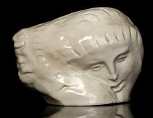 A MODERN CERAMIC SCULPTURE, in the manner of Eric Gill, with soft white glaze, signed with artists monogram, (13cm high)