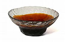 A MODERN SCANDINAVIAN GLASS BOWL - clear and amber glass, with textured exterior, engraved with maker's marks under, (24.5cm under)