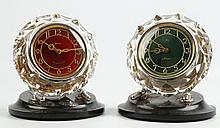 A PAIR OF 1950's RUSSIAN CLOCKS - with faceted glass surrounds, and enamelled dials in red and green, manufactured by Maak CCCP, (19cm high)