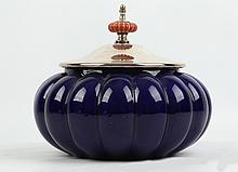 CHRISTIAN DIOR -  a ceramic pot in the form of a pumpkin in dark blue glaze, with silver plated lid and rim, stamped with maker's mark to rim, (22cm high)