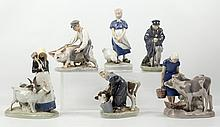 ROYAL COPENHAGEN, DENMARK - three 1960's ceramic figures, consisting of a pair with fuan seated on a plinth, and one of a budgie, maker's marks under, (21.5cm high (2) + 15cm high)