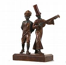 An early 20th century, Austrian Bergman foundry bronze, cold painted group of Mardi Gras Stovepipes Band, see Harold Berman book; Bronze Scuptors and Founders' page 762-763, 16cm high.