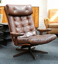A 1970's brown leather swivel lounge chair, manufactured by Gote Mobler, Sweden (74cm wide).