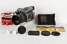 A Hasselblad H1 Medium format camera with Hasselblad HC F2.8 80mm Lens also with HasselbladHMi100 Instant Film back and Hasselblad Film Magazine HM16-32. Includes maker?s caps & covers, batteries and Ilford FP4 Film.