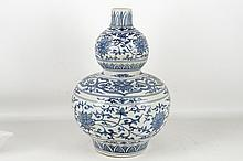 A Chinese blue and white double guard vase, 41cm high.