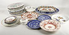 An interesting collection of pottery and porcelain plates and serving dishes, including a set of four Chinese saucers, a Minton bowl, a Portuguese pierced dish, an Imari charger, a Chinese plate decorated with a dragon in orange, a pair of Portmeirion botanical plates and various other printed plates and platters, etc (Qty).
