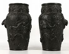 A pair of Japanese bronze vases modelled in high relief as cranes amongst clouds, 25cm high (2).