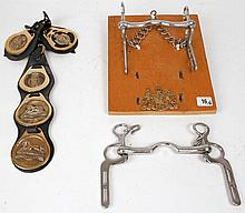 A mounted military horse bit and horse brasses for