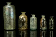 FIVE POST-MEDIEVAL GLASS APOTHECARY PHIALS  England, circa 17th-18th Century  With cylindrical bodies, 6cm-15cm high (5)  Provenance: the largest found in the river Thames. The others excavated in Worcester in the 1960s.