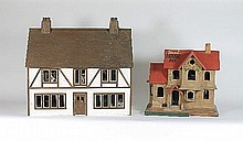 A 20th Century dolls' house with mullion windows