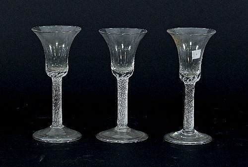 Three 18th Century Wine Glasses With Airtwist Stems On A Fol