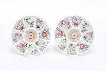 A pair of Chinese famille rose saucer dishes painted with ribbon-tied auspicious objects, 15cm diameter, apocryphal marks