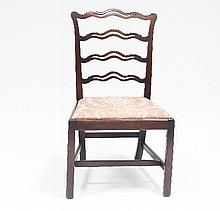 A George III mahogany ladderback dining chair with drop-in seat and square chamfered legs