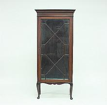 An Edwardian mahogany display cabinet on stand, with astragal glazed door on turned legs with pad feet, 151cm high
