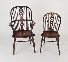 A set of twelve ash and elm wheel back Windsor chairs, including two armchairs/see illustration