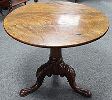A George II mahogany tripod table, the circular top on birdcage action column and leaf carved cabriole legs, 72cm x 86cm