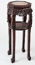 A Chinese hardwood jardiniere stand with octagonal marble top on scroll carved four legged base with claw and ball feet, 84cm high/see illustration